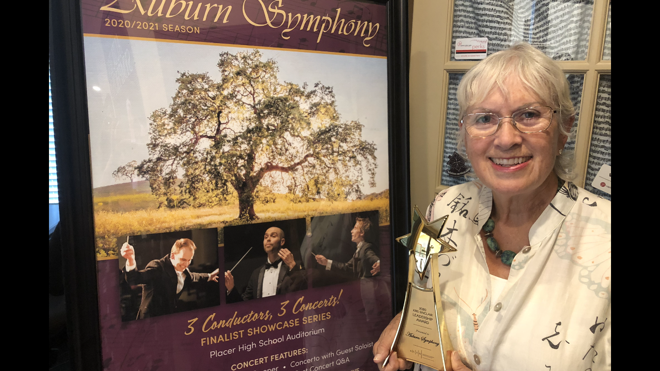 Auburn Board President Stephanie Snyder holds the Kir Sinclair Leadership Award